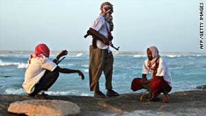Pirates keep watch on a Somali beach in January.