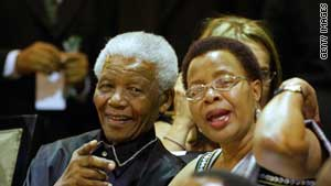 Nelson Mandela and his wife, Graca Machel, made a rare appearance Thursday as the nation's parliament honored him.