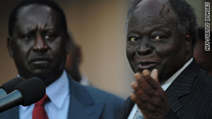 Kenyan President Mwai Kibaki, right, stands alongside Prime Minister Raila Odinga in July 2009.