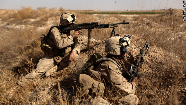 U.S. marines take cover from sniper fire in Trikh Nawar, a poppy farmland area on the outskirts of Marjah, on Thursday.
