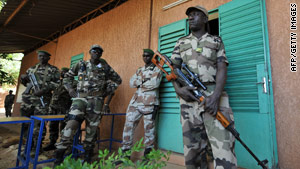 Soldiers stand outside the office of the coup's leader, Salou Djibo, in Niger's capital on Sunday.