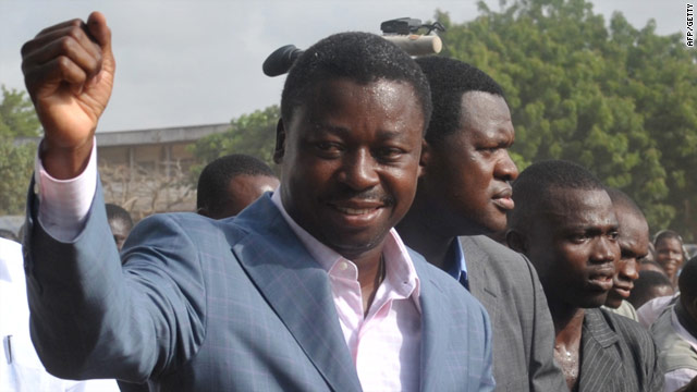 Togolese President Faure Gnassingbe greets supporters March 4 after casting his vote in Lome, Togo.