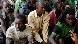 People suspected of involvement in violence are shown at Jos police headquarters on Wednesday.