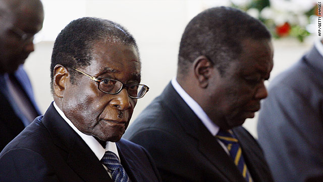 Bitter political rivals President Robert Mugabe (left) and opposition party leader Morgan Tsvangirai formed an uneasy alliance.