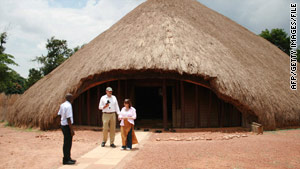 Tourists pose in 2006 outside the Tombs of the Buganda Kings near Kampala, Uganda.