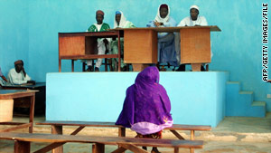 A woman appears before an Islamic court in Nigeria in 2002.
