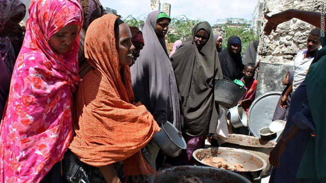 Internally displaced Somali women queue for food aid at a distribution center in Mogadishu.