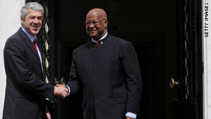 Guinea-Bissau Prime Minister Carlos Gomes Jr., right, is welcomed March 17 by his Portuguese counterpart in Lisbon.
