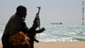 A Somali pirate watches a hijacked ship just off the Somali coast in January.