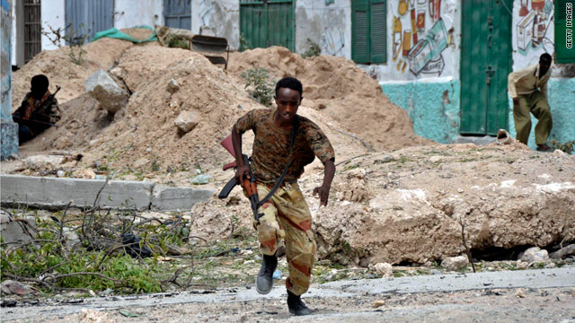 A Somali soldier runs for cover during heavy clashes in northern Mogadishu in mid-March during fighting between government troops and insurgent forces.