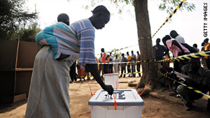 A South Sudanese woman casts her ballot on Sunday.