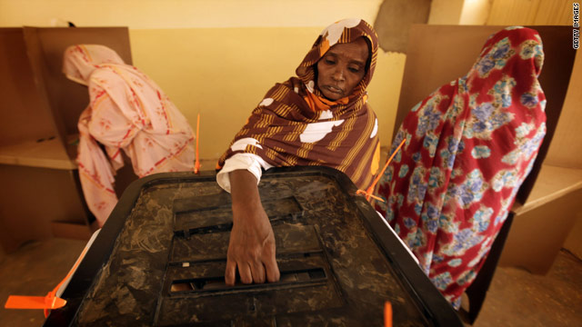 A woman casts her ballot at a polling station in the village of Umm Dawban, 40 kilometers north of Khartoum, on Tuesday.