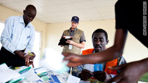 An election observer monitors the counting of ballots at a polling station at a military barracks in southern Sudan.