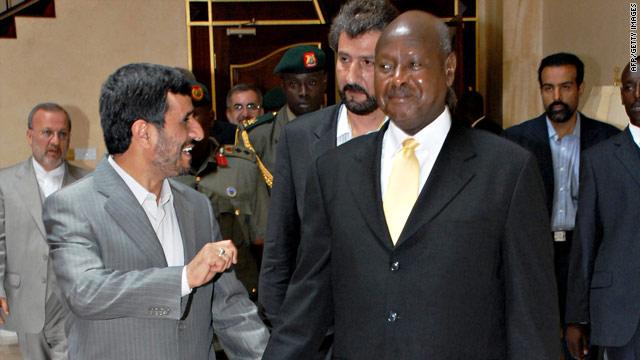 Iranian President Mahmoud Ahmadinejad (left) walks with Ugandan counterpart Yoweri Museveni during his visit.