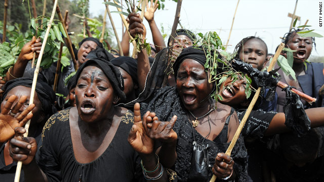 Women in Jos, Nigeria, mourn as they march against a recent bout of sectarian violence between Muslims and Christians.