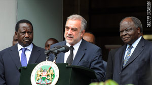 ICC prosecutor Luis Moreno-Ocampo is flanked by Kenya President Mwai Kibaki, right, and Prime Minister Raila Odinga.