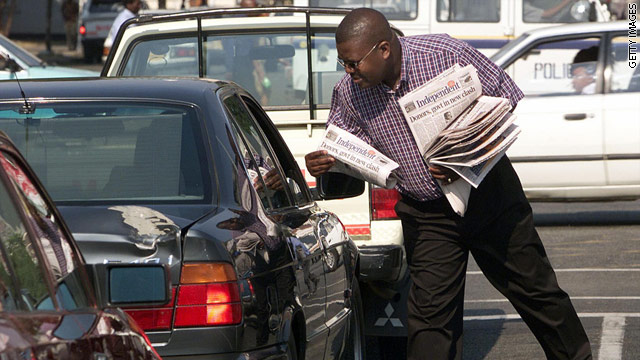 Newspaper publisher Trevor Ncube is seen handing out copies of his weekly newspaper, the Independent