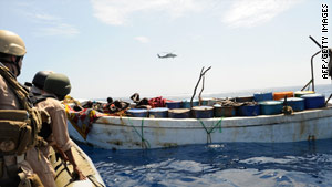 U.S. naval forces investigate a suspected pirate skiff in the Gulf of Aden earlier this year.