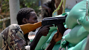 A Somali government soldier exchange fire with Islamist rebels in Mogadishu on March 23, 2010.