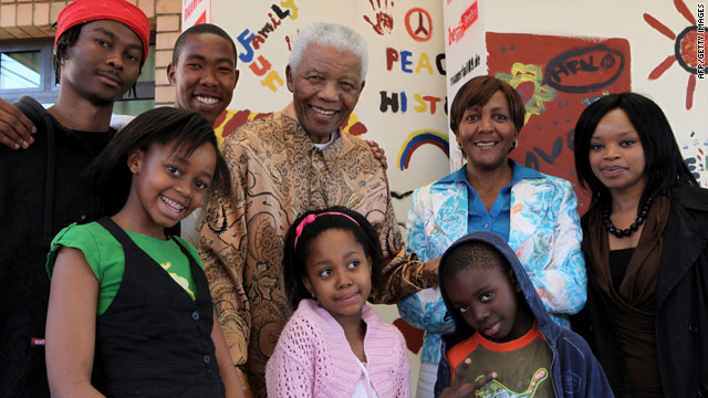 Zenani Mandela, wearing green, with her great-grandfather and other family members in a photo taken on August 17, 2009.