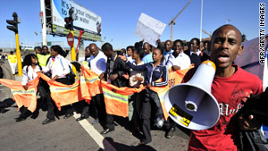 Protesters demonstrate against the firing of security staff at the 2010 FIFA World Cup in South Africa.
