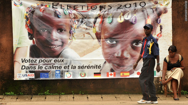 "A banner in Conakry, Guinea, on Friday urges people to vote in ""calm and serenity"" during Sunday's balloting."