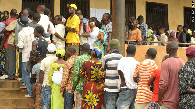 Voters queue outside a polling station in Conakry, the Guinean capital.