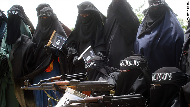 Women pose with weapons at an Al-Shabaab demonstration against the Somali government in Mogadishu.