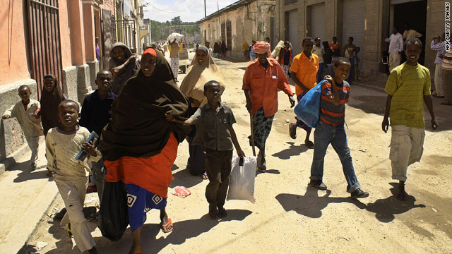 Residents of Mogadishu flee with their belongings from Hamarweyne District of the embattled Somalia capital on July 19, 2010.