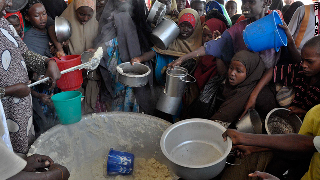 Somalia's displaced people jostle for food rations distributed by Mogadishu based Jumbo Organization at a feeding centre in southern Mogadishu on June 30, 2010.
