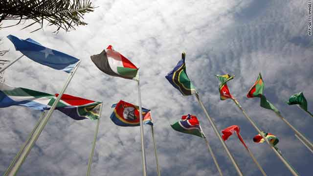 Flags representing some of the 30 nations taking part in the African Union Summit flutter in Kampala, Uganda, Monday.