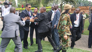 Guards for Libyan President Moammar Gadhafi scuffle with Ugandan security personnel.