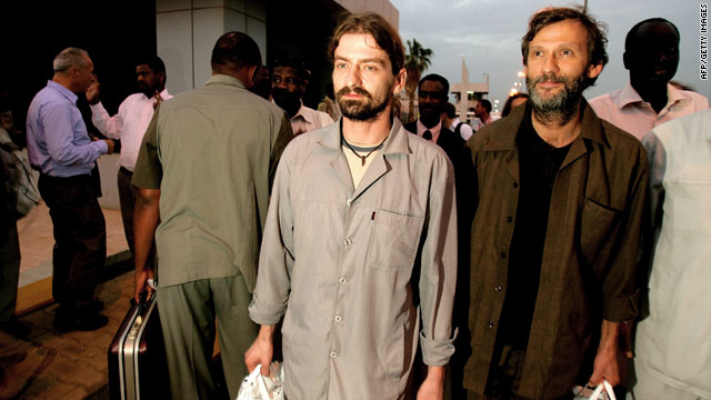Two German aid workers who were kidnapped in Darfur arrive in Khartoum after being freed on July 27, 2010.