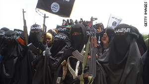 Somali women carry weapons during a demonstration organized by Al-Shabaab in Mogadishu on July 5, 2010.