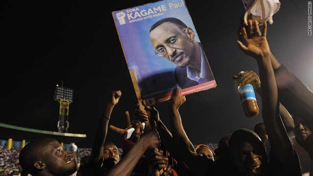 Rwandan President Paul Kagame's supporters hold up his poster during a celebration rally at Kigali's Amahoro Stadium Tuesday.