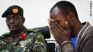 """Suspect Idris Nsubuga, right, says, """"I didn't know the impact of those explosives."""""""