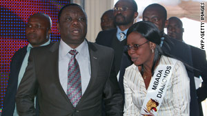 Zimbabwean Prime Minister Morgan Tsvangirai arrives at Harare airport for the launch of the country's diamond sale.