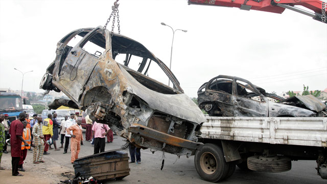 A badly damaged vehicle is lifted after being caught up in the crash outside Lagos on Sunday in which 15 died.