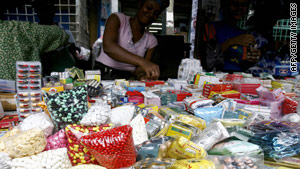 Women sell smuggled, counterfeit medicine in June 2007 at a market in Abidjan, Ivory Coast.