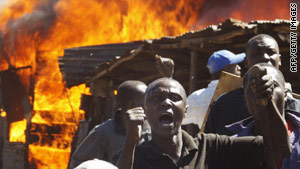 Residents of a Nairobi slum shout at demonstrators during clashes after the 2007 disputed election.