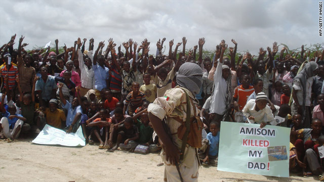Somali men carry weapons during a demonstration organized by the Al-Shabaab group in July 2010.