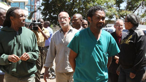 From left: Gregory Miller, Anthony Jones, David Greenberg and Gloria Cox-Crowell head to court in Harare.