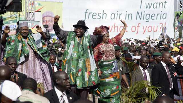 Goodluck Jonathan and his wife wife, Patience, leave a rally in Abuja on September 18 after he declared his intention to run for president in 2011.