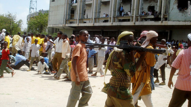 Armed members of the extremist Islamic Al Shabab group at a demonstration at the city's stadium in Mogadishu on September 15.