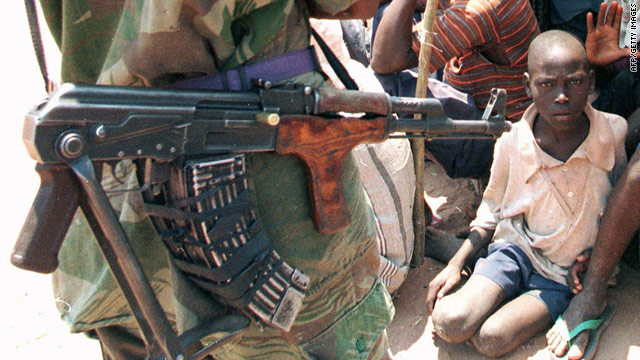 An image taken on September 2, 1998, of an armed rebel soldier near a group of people in Kalemie, in the eastern part of the DRC.