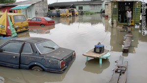 The flooding began last month when the Ogun River rose above its banks after the opening of a dam.