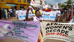 A Congolese woman participates in the 'World March of Women' in the Democratic Republic of Congo on October 17.