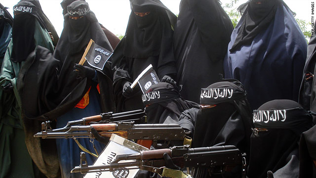Somali women carry weapons during a demonstration organized by the islamist Al-Shabaab group iin Mogadishu on July 5, 2010.