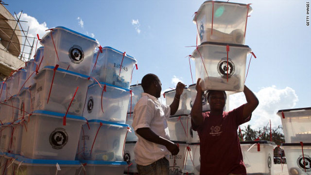 Election officials collect ballot boxes at a tallying center in Dar Es Salaam on November 1.
