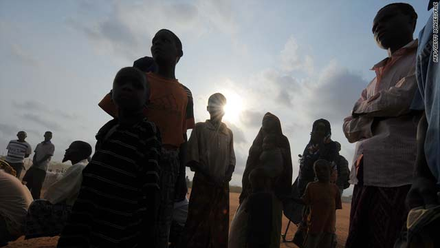 Newly arrived Somali refugees stand outside the UNHCR registration centre at the Ifo camp in Dadaab, Kenya, on September 9.